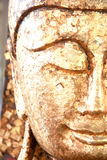Face of the gold buddha Stock Photography