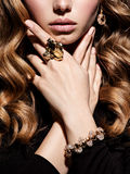 Face and gold jewelry Royalty Free Stock Photos