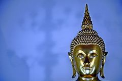 Face of golden budda. Metal royalty free stock photo