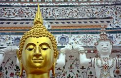 Face of golden buddha sculpture, Thailand. Beautiful face of golden buddha sculpture, Thailand Royalty Free Stock Images