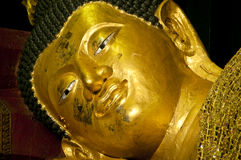 The face of golden buddha in sleeping posture Royalty Free Stock Photo