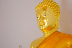 Face of golden buddha statue and thai art architecture in Wat Bovoranives, Bangkok, Thailand. Royalty Free Stock Photos