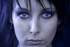 Face of a Goth Woman. Portrait of the face of a goth woman with striking green eyes, and a distant, cold stare Stock Photo