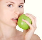 Face and green apple Stock Images