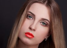 Face, green eyes, black background, red lips, ombre Royalty Free Stock Photography
