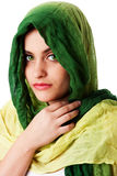 Face with green eyes and scarf. Portrait of mysterious beautiful Caucasian Middle Eastern woman face with green penetrating eyes and green fashion scarf wrapped Royalty Free Stock Photography