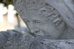 Face of a greiving lady. A close up of the face of the weeping lady grave marker, the likeness of the wife of the man buried below Royalty Free Stock Image