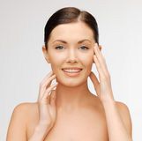 Face and hands of beautiful woman Royalty Free Stock Photography