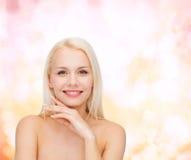 Face and hands of beautiful woman Stock Photos