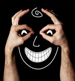 Face with hands happiness facial expression on black background  Royalty Free Stock Images
