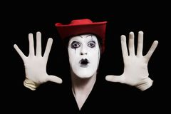 Face and hands of mime with dark make-up Royalty Free Stock Photos