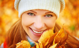 Face of happy girl with autumn leaves on walk Royalty Free Stock Photos