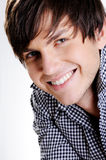 Face of a happy  handsome young guy Royalty Free Stock Images