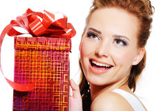 Face of a happy laughing woman with red box Stock Photo