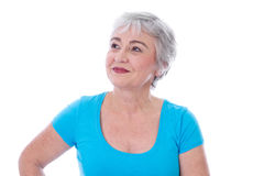 Face of happy senior woman - isolated, turquoise Royalty Free Stock Photos