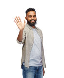 Face of happy smiling man waving hand over white. People, emotion and facial expression concept - face of happy smiling middle aged man waving hand over white Royalty Free Stock Photos