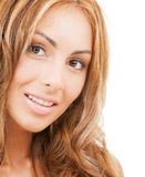 Face of happy woman with long hair Royalty Free Stock Images