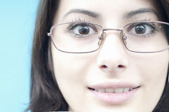 Face of a happy woman wearing glasses Royalty Free Stock Image