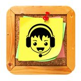 Face with Headset Icon on Message Board. Face with Headset Icon on Yellow Sticker on Cork Message Board. Live Support Concept Royalty Free Stock Images