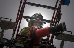 The face of help. Fireman on aerial ready to work Royalty Free Stock Images