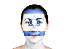 Face with the Israel flag. Face of a woman with the Israel flag stock photography