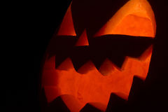 Face of Jack of the Lantern on black Stock Images