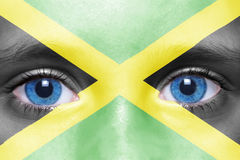 Face with jamaican flag. Human`s face with jamaican flag stock images