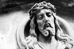 Face of Jesus Christ on a tomb Stock Image