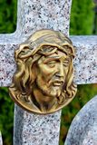 Face of Jesus, old statue in cemetery Stock Photos
