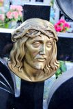 Face of Jesus, old statue in cemetery Stock Image