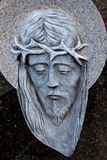 Face of Jesus, old statue in cemetery Stock Photo