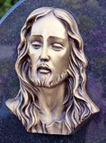 Face of Jesus, old statue in cemetery Royalty Free Stock Photography