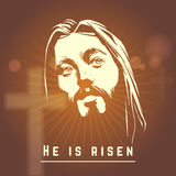 Face of Jesus with He is risen text. Easter Stock Image