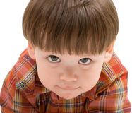 Face of a kid looking at you Stock Photo