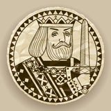 Face of King on round crumpled paper background Royalty Free Stock Photography