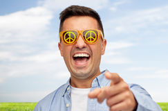 Face of laughing man in green peace sunglasses Stock Images