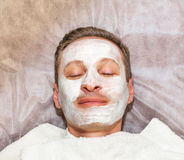 Face of laying man with cream mask Stock Images