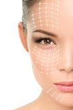 Face lift anti-aging treatment - Asian woman. Portrait with graphic lines showing facial lifting effect on skin stock photos