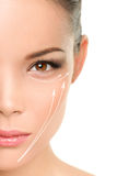 Face lift anti-aging treatment - Asian woman. Portrait with graphic lines showing facial lifting effect on skin royalty free stock images