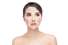 Face lift anti-aging treatment. PortraitAsian woman with graphic lines showing facial lifting effect on skin,antiaging concept Royalty Free Stock Photo
