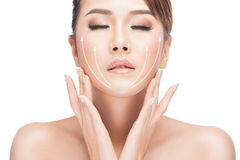 Face lift anti-aging treatment. PortraitAsian woman with graphic lines showing facial lifting effect on skin,antiaging concept stock photography