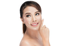 Face lift anti-aging treatment. PortraitAsian woman with graphic lines showing facial lifting effect on skin,antiaging concept Stock Images