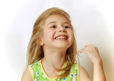 Face of little blond girl laughing royalty free stock photo