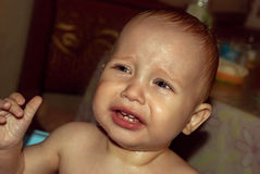 Face of little boy crying in the bathroom. Stock Images