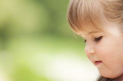 Face of little girl in the park Royalty Free Stock Images