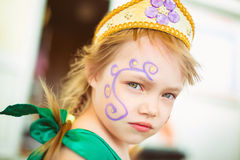 Face of a little girl with a picture Royalty Free Stock Photography