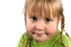 Face a little girl with pigtails closeup Stock Photography