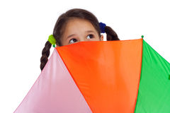Face of little girl with umbrella, looking up. Face of little girl holding colored umbrella and looking to sky Royalty Free Stock Photo