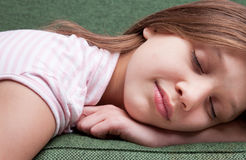 Face of a little sweet girl sleeping on a sofa Royalty Free Stock Image
