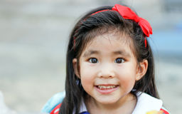 Face of long hair with red headband asian Thai girl funny smile Stock Photo